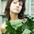Young pretty woman in the garden — Stock Photo