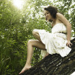 Young fine woman on tree — Stock Photo
