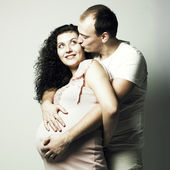 Happy pregnant woman with husband — Stockfoto
