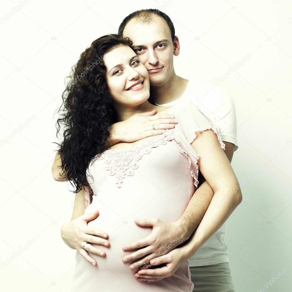 Fine art portrait of happy pregnant woman with husband — Stock Photo #2735626