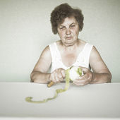 Gracious senior lady portrait with apple — Stock Photo