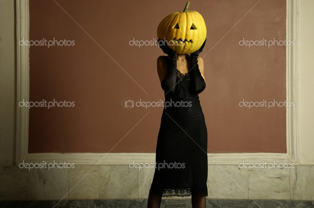 Sexy lady with big pumpkin on head. Surrealstic portrait.  Stock Photo #2789582