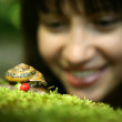 Young woman and snail - Stock Photo