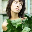 Young pretty woman in the garden - Stock Photo