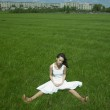 Beautiful young woman on a green field — Stock Photo #2877704