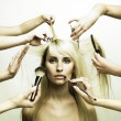 Model and hands of stylists — Stock Photo