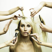 Model and hands of stylists — Stockfoto