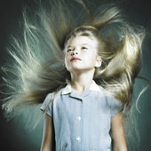 Little girl with magnificent hair — Stock Photo