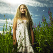 Girl in flower meadow — Stock fotografie