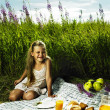 Little girl at picnic - Stock Photo
