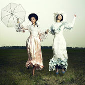 Two woman in vintage dress — Stock Photo