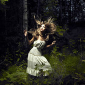 Girl in fairy forest — Photo