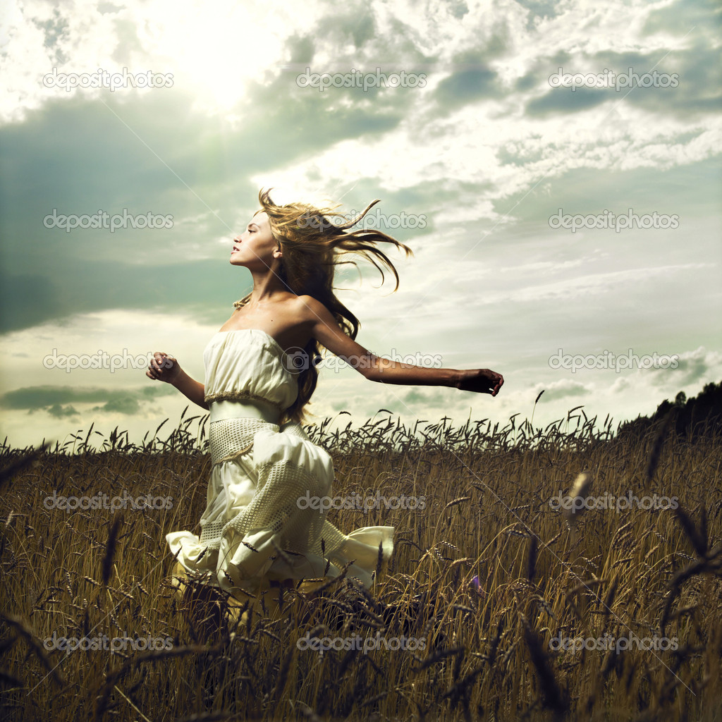 Portrait of romantic woman running across field — Photo #3730584