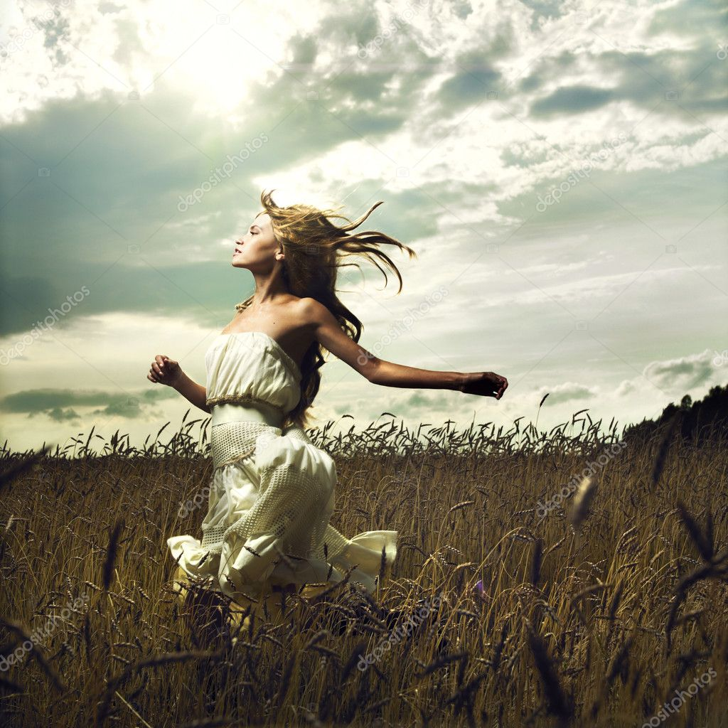 Portrait of romantic woman running across field — Stock Photo #3730584