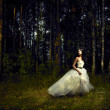 Romantic girl in fairy forest — Stockfoto