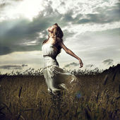 Jump women in wheat field — Stock Photo