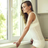 Girl at the window — Stock Photo