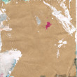 Beautiful green, pink and white paint splatters on classic brown paper - Stock Photo