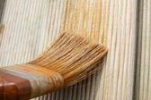 Painting brush on wood — Stock Photo