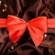 Red ribbon with brown smooth textile — Stock Photo