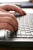 Hands typing on keyboard — Stock Photo