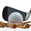 Iron with golf balls and tee - Stock Photo