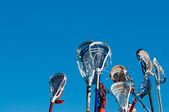 Many lacrosse sticks in the air — Stock Photo