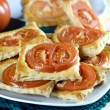 Freshly flaky baked  with tomatoes — 图库照片