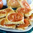 Freshly flaky baked  with tomatoes — Stock Photo