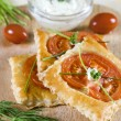 Appetizer puff pastry with tomato — Stock Photo #2815800