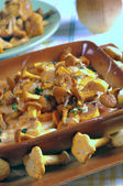 Fried golden chanterelles — Stock Photo