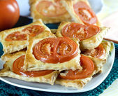 Freshly flaky baked with tomatoes — Stockfoto