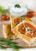 Appetizer puff pastry with tomato — Stock Photo