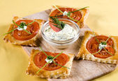 Appetizer puff pastry on board — Stock Photo