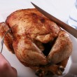 Carving Rotisserie chicken — Stock Photo