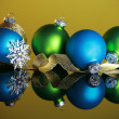 Christmas ornaments on yellow background — Stock Photo
