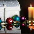 Foto Stock: Christmas ornaments and lit candles