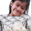 Asian child holding white roses — Stock Photo