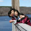 Stock Photo: Four children on outdoor deck