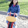 Girl playing on playground rocking horse — Stock Photo #2966452
