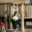 Teenage girl playing at playground — Stock Photo