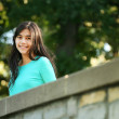 Stock Photo: Young teen girl standing on bridge