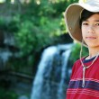 Stock Photo: Young boy standing nect to water fall