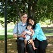 Stock Photo: Family of three on swing