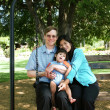 Family of three on swing — Stock Photo