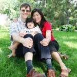 Happy family of three, multiracial — Stock Photo