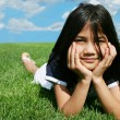 Stock Photo: Little girl lying on grass in summer