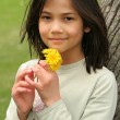 Girl holding dandelions — Stock Photo
