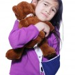 Little girl with broken arm holding doll — Stock Photo #3126681