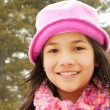 Child smiling outdoors in winter — Stock Photo #3126754